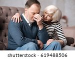 aged woman calming down her... | Shutterstock . vector #619488506