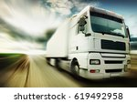 truck speeding at country road | Shutterstock . vector #619492958