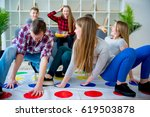 friends playing twister | Shutterstock . vector #619503878