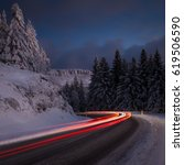 a long exposure of a snowy road ... | Shutterstock . vector #619506590