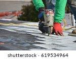 nailing down shingles | Shutterstock . vector #619534964