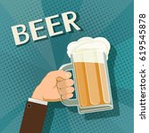 human hand holds a mug of beer. ...   Shutterstock .eps vector #619545878