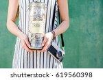 woman holding a jar full of... | Shutterstock . vector #619560398