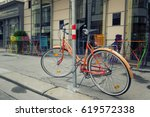 bicycle parked at street ... | Shutterstock . vector #619572338
