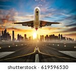 landing commercial airplane at... | Shutterstock . vector #619596530