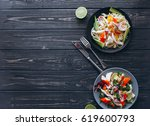 salad and pasta with seafood on ... | Shutterstock . vector #619600793