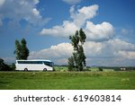 the white bus traveling on the... | Shutterstock . vector #619603814