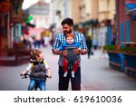 happy father and two sons on...   Shutterstock . vector #619610036