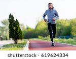 man jogging in the morning out... | Shutterstock . vector #619624334