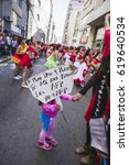 """Small photo of Valparaiso, Chile - August 21, 2016: Women dance in a carnival during a protest while a girl holds a banner """"Whith only bread whith only tea, AFP have us like this""""."""