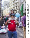 Small photo of Valparaiso, Chile - August 21, 2016: Grandfather and granddaughter protest the pension system in Chile.Chileans marched through Valparaiso's streets, demanding an end to the private pension system AFP