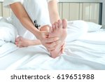 foot pain woman sitting on the... | Shutterstock . vector #619651988