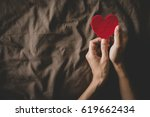 vintage photo of hand holding... | Shutterstock . vector #619662434