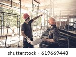 two business man construction... | Shutterstock . vector #619669448