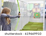 girl shoots a bow in a children'... | Shutterstock . vector #619669910