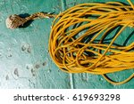 Small photo of Monkey's fist knot used onboard construction barge offshore to throw as a messenger or feeder line before sending a heavier line