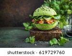 healthy raw avocado burger with ...   Shutterstock . vector #619729760