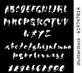hand drawn dry brush font....   Shutterstock .eps vector #619747814