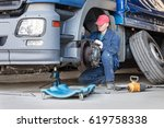 mechanic repair truck is on the ... | Shutterstock . vector #619758338