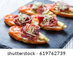 appetizer bruschetta with... | Shutterstock . vector #619762739