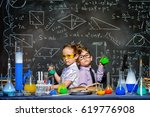two little children scientists... | Shutterstock . vector #619776908