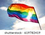 gay flag on sky background | Shutterstock . vector #619782419