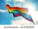 gay flag on sky background | Shutterstock . vector #619782509