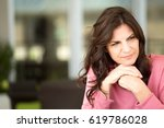 middle age woman looking sad. | Shutterstock . vector #619786028