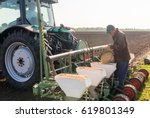 Farmer With Can Pouring Soy...
