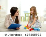 young child psychologist... | Shutterstock . vector #619805933