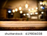 image of wooden table in front... | Shutterstock . vector #619806038