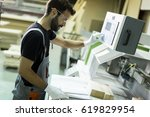 handsome young man working in... | Shutterstock . vector #619829954