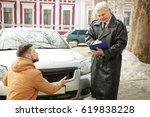Small photo of Driver explaining details of accident to loss adjuster