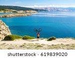mountain biker celebrating and... | Shutterstock . vector #619839020
