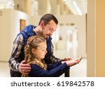 young father and daughter... | Shutterstock . vector #619842578