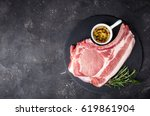 raw meat with herbs  olive oil... | Shutterstock . vector #619861904