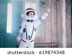 boy in astronaut costume flying ...   Shutterstock . vector #619874348