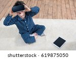 boy with virtual reality... | Shutterstock . vector #619875050