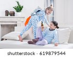 kids in pajamas playing... | Shutterstock . vector #619879544