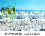 summer drink on white table... | Shutterstock . vector #619884608