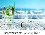 summer drink on white table... | Shutterstock . vector #619884614