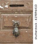 Old Wooden Door With A Metal...