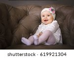 Small photo of surprised kid sitting at table. child's eyes widened and mouth opened in amazement. copy space for your text