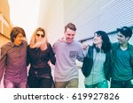 Stock photo group of friends multiethnic millenials walking arm aroung outdoor having fun togetherness 619927826