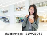 woman use of cellphone in... | Shutterstock . vector #619929056
