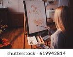 artist  a european girl  paints ...   Shutterstock . vector #619942814
