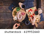a woman and a man eat a set of... | Shutterstock . vector #619952660