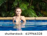 young girl in the pool. woman... | Shutterstock . vector #619966328