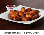 chicken wings on white plate... | Shutterstock . vector #619970954