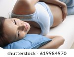 pregnant woman lying down  head ... | Shutterstock . vector #619984970